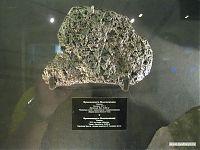 Кусок железного метеорита интересной пористой структуры.