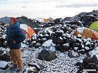 Лагерь засыпало снегом.