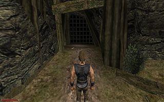Проход в Заброшенную шахту. Рядом с решёткой лежит кирка.