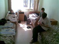 Номера. Мягкие кровати, стеклопакеты на окнах, душ и туалет в номере, а также по две розетки, спрятанные за каждой кроватью, прилагаются =)